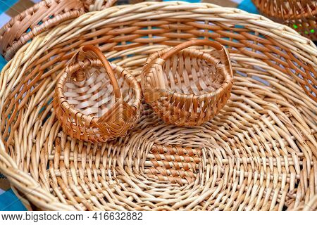 Two Small Wicker Baskets Made Of Natural Vines Are Already Inside The Large Basket. Wicker Baskets M