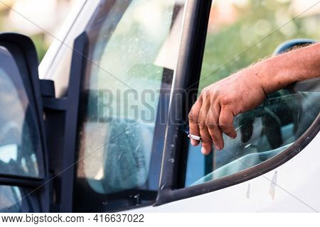 Driver Holding Hand On Car Door With Open Window, Waiting In Traffic Concept Close Up. Bucharest, Ro