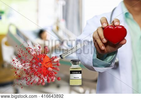 Coronavirus Covid-19 Vaccine In Bottle And Syringe During Injection To Destruction Virus Model With