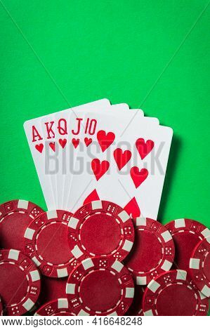A Winning Poker Combination Is A Royal Flush. Chips And Cards On The Green Table In The Poker Club.