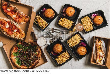 Lockdown Fast Food Dinner With Burgers, Beer, Pizza