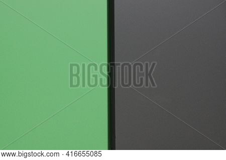 Colored Texture From A Part Of A Metal Gray Green Wall With A Seam