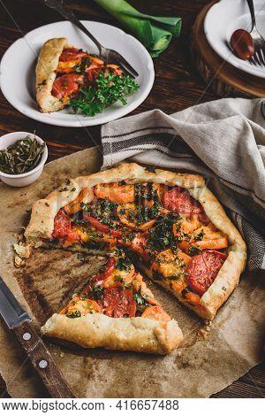 Freshly Baked And Sliced Tomato Galette On Baking Paper