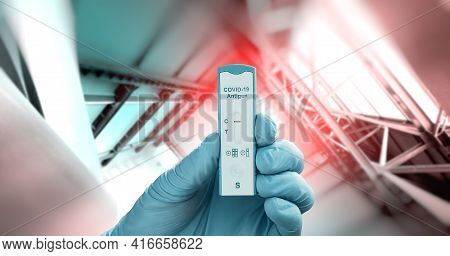 Hand In Protective Glove Hold Express Covid-19 Antigen Test For Quick Testing Of Coronavirus Infecti