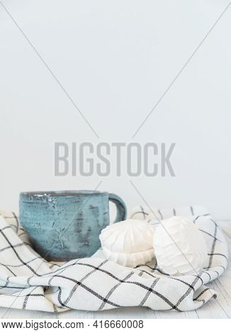 Still Life A Ceramic Cup With Hot Drink, Sweet Candies And Napkin On Light Background. Sweet Food An