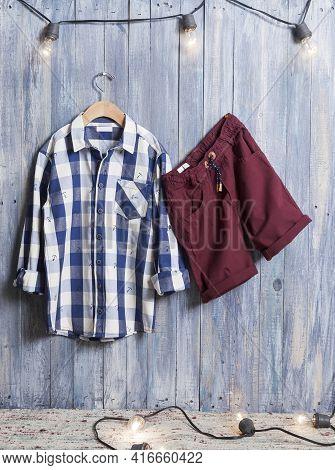 Kids Fashion - Long Sleeve Shirt And Shorts Set For Boys; Photo On Wooden Background.