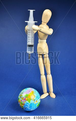 The Covid-19 Vaccine With A Syringe. The Concept Of Protecting The Globe, Mass Vaccination