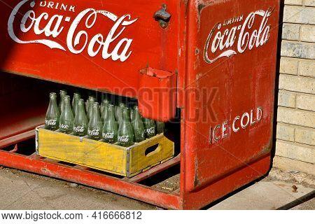 Ulen, Minnesota, April 9, 2021:the Old Coca Cola Bottling Machine Advertises  The Soft Drink Invente