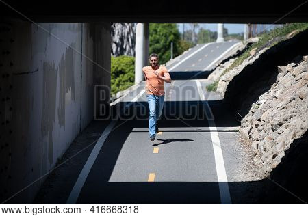 Full Length Of Healthy Man Running And Sprinting Outdoors. Young Fitness Sport Male Runner Running O