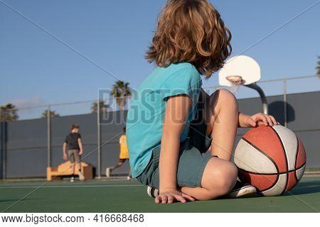 Basketball Kids Game. Cute Little Child Boy Holding A Basket Ball Trying Make A Score