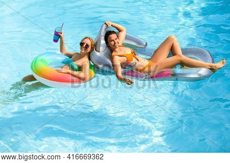 Summer Sensual Girls In Pool. Summertime Swimming Pool. Summer Leisure And Holiday. Woman On Summer