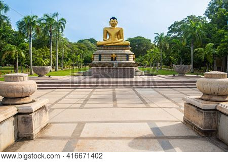 An Iconic Golden Buddha Statue In Viharamahadevi Park A Public Park Located In Colombo, Sri Lanka. V