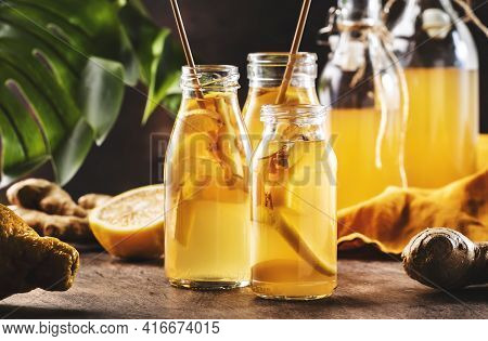 Fermented Kombucha Healthy Drink With Raw Ginger And Lemon In Glass Bottles.tea Ready To Drink