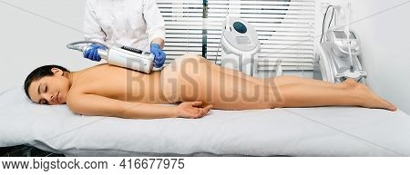 Brunette Woman Enjoys Back Massage With Endosphere Machine For Anti-cellulite And Body Correction