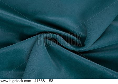 Turquoise Fabric Texture - Top View And Close-up Of A Piece Of Crushed And Twisted Turquoise Velvet