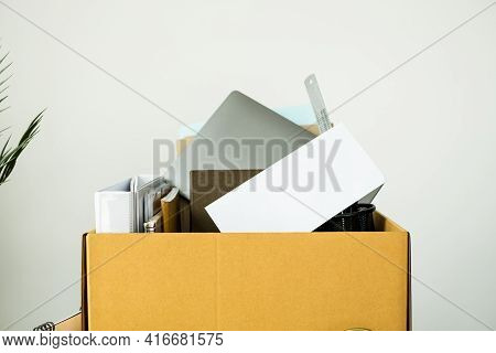 Dismissal Concept. Cardboard Boxes Containing Belongings On The Table.