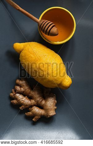 Useful Products For Strengthening Health And Immunity Lemon, Ginger And Honey On Blue Background