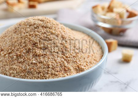 Fresh Breadcrumbs In Bowl On White Marble Table, Closeup