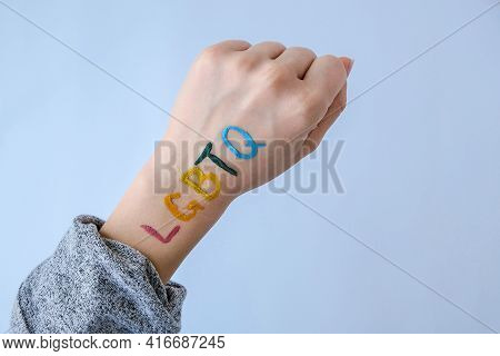 Rainbow Lgbtq Flag Painted On Hand. Support For Lgbt Community. Honour Of Pride Month. Connecting Pe