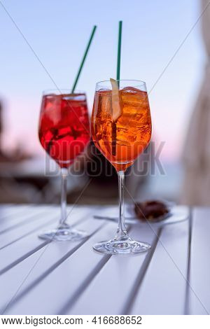 Two Italian Aperitifs By The Sea At Sunset (vertical Photo)