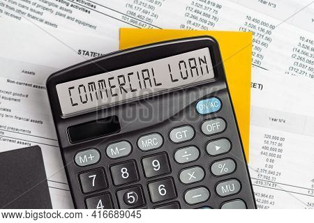 Commercial Loan. On Display Of Calculator Is Written Commercial Loan