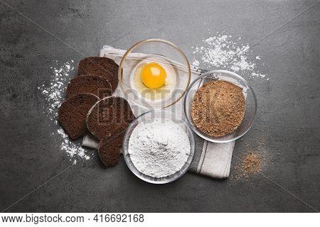 Fresh Breadcrumbs, Flour And Egg On Grey Table, Flat Lay