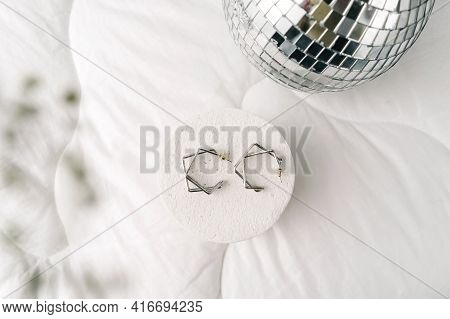 Silver Modern Bijouterie Earrings On White Background.