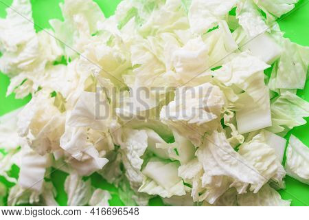 Sliced Leaves Of Beijing Cabbage On A Green Background. Healthy Food. Sliced Cabbage.
