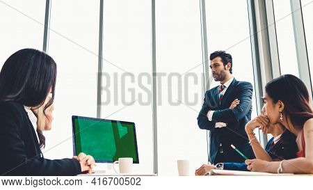 Business People In The Conference Room With Green Screen Chroma Key Tv Or Computer On The Office Tab