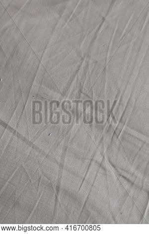 A Nice Crumpled Fabric With Creases Of Beige Sand Color Can Be A Tablecloth Or A Sheet Used As A Bac
