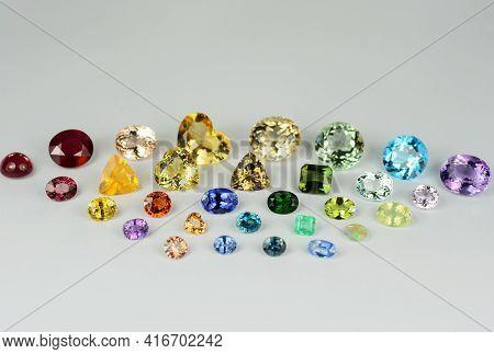 Natural Preciuos, Semi-precious Faceted Polished Gemstones Lot, Horizontal Front Photo Light Gray Ba