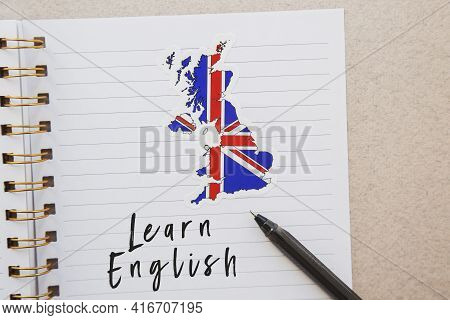 Notepad With The Inscription Learn English, Flag Of The Great Britain And Country Map, Pen, Foreign