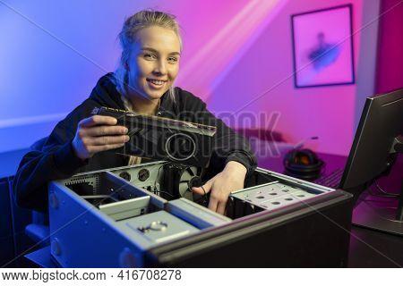 Smiling E-sport Gamer Girl Installing New Gpu Video Card In Her Gaming Pc