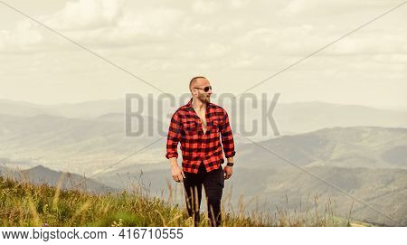 Masculine Power. Tourist Walking Mountain Hill. Power Of Nature. Man Stand On Top Of Mountain Landsc