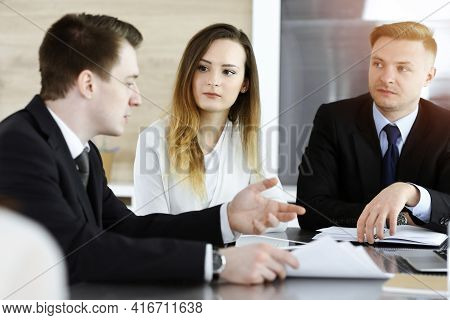 Business People Or Lawyers Discussing Questions At Meeting In Sunny Office. Unknown Businessman And