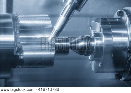 The Turn-mill Machine Cutting The Metal Cylinder Shape Part With Milling Spindle. The Hi-precision A