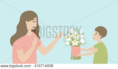 The Son Gives His Mother A Bouquet Of Daffodils. Boy With Flowers. Mom Admires A Bouquet Of Flowers.