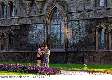 Khryashchevka, Russia, July 16, 2020, Garibaldi Castle, Woman And Young Woman Are Looking At Photogr