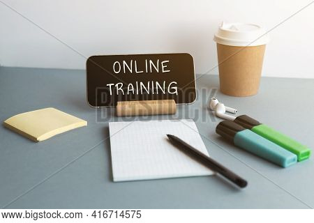 Smartphone, Wireless Headphones, Notepad, Markers, Coffee Cup Inscription Online Training Education