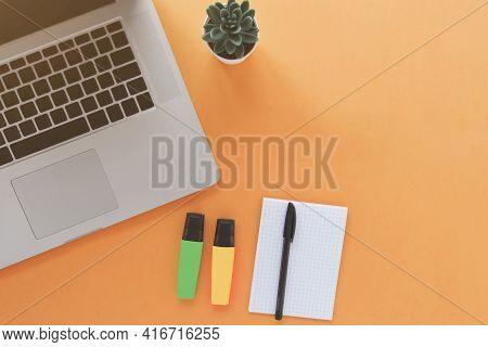 Laptop, Notebook On Orange Background, E Education Concept