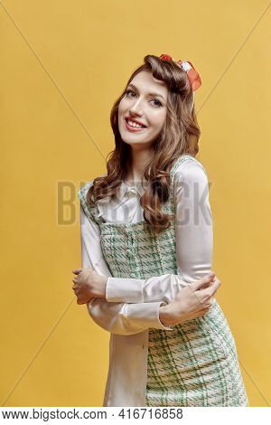 Portrait Of A Young Beautiful Brunette Woman With Wavy Hair. Pin-up Style.