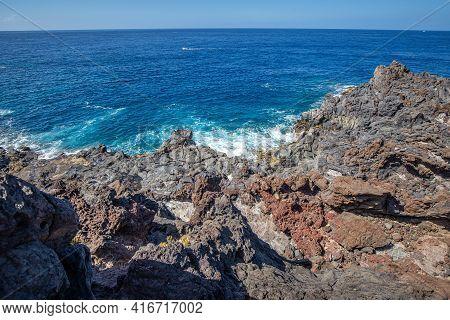 Crashing Waves On Volcanic Coastline Of Tenerife