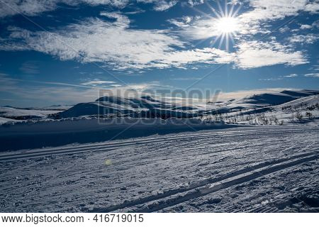 Cross Country Skiing Tracks In A Nordic Mountain Terrain.