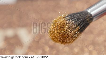 Brush Gains Glitter To Be Used In Make-up. Macro View Of Working Process, Tools In Beauty Industry.