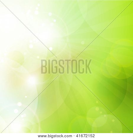 Abstract green blurry background with overlying semitransparent circles, light effects and sun burst. Great spring or green environmental background. Space for your text.