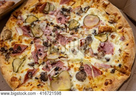 Top View Of An Appetizing Whole Pizza In A Cardboard Box.