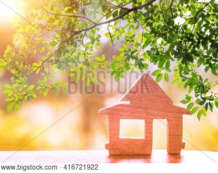 Sunshine Through Wooden House Model There Space. Home, Housing And Real Estate Concept