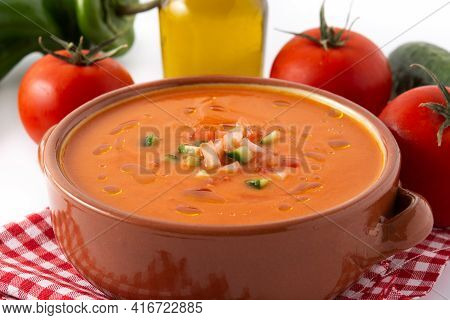 Gazpacho Soup In Crock Pot And Ingredients Isolated On White Background.