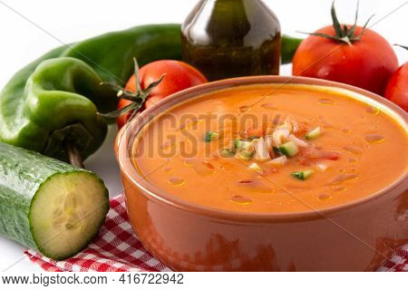 Gazpacho Soup In Crock Pot And Ingredients Isolated On White Background. Close Up