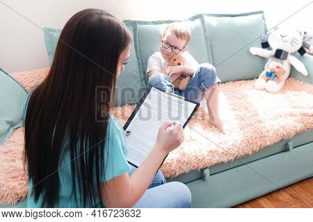 Boy In A Psychologist's Office. Psychologist Talking To A Child, Student Problems. Emotional Support